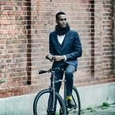 Man in Suit Wearing Hovding Airbag for Cyclist