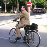 Man in Suit Commuting on a Bicycle