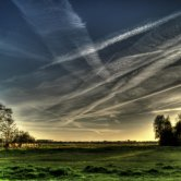 Airplane Contrails in the Sky of a Country Side